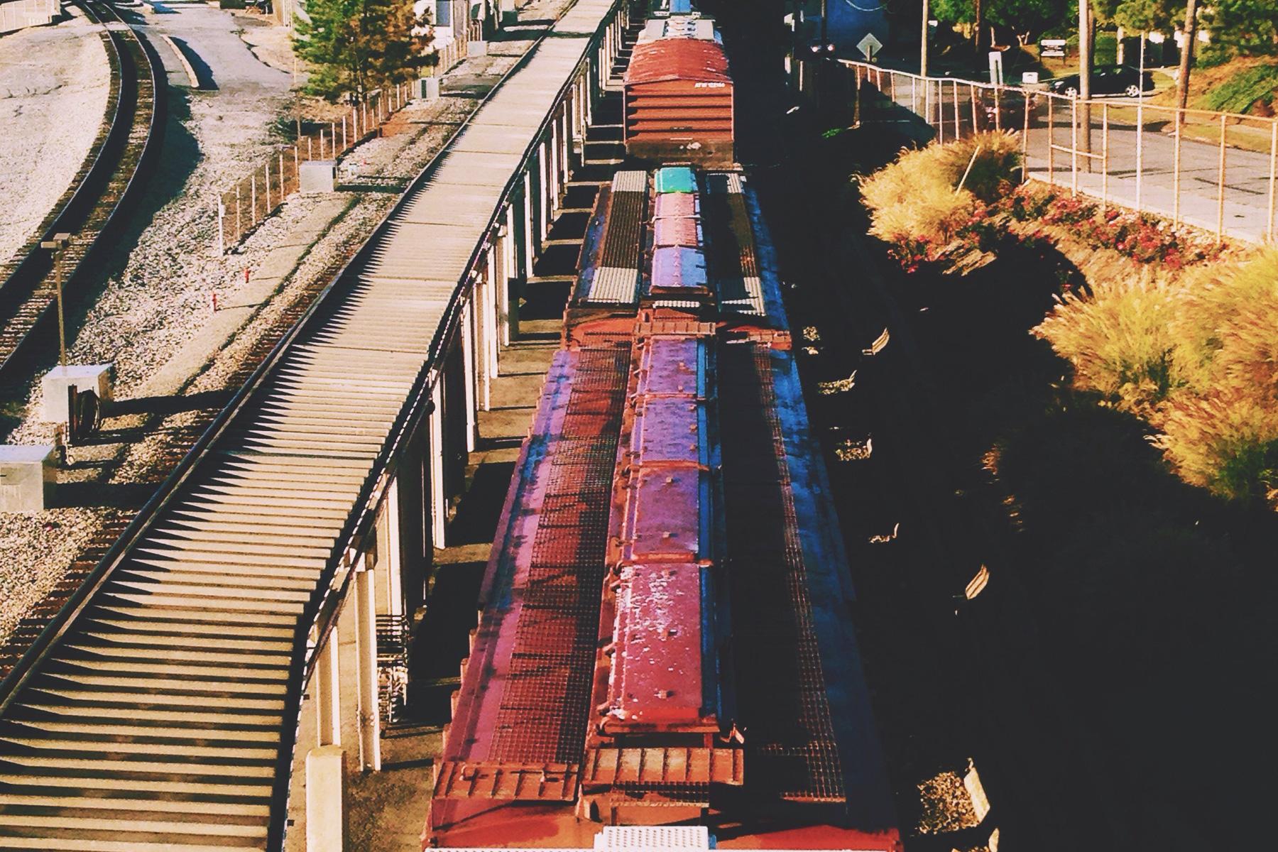 Long train going through city