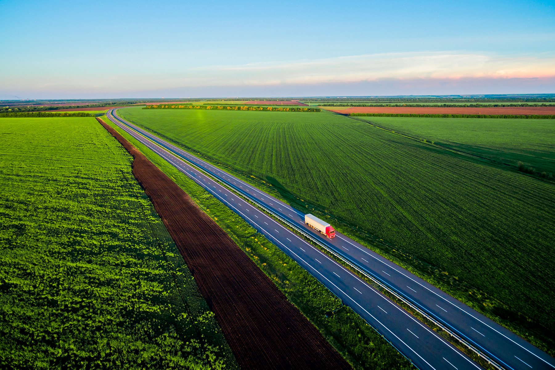 Lorry surrounded by fields