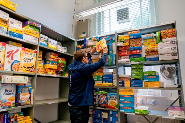 Person stocking food bank shelves
